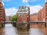Waterfront Warehouses in the Speicherstadt Warehouse District of Hamburg, Germany Stampa fotografica di Miva Stock