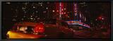 Car on a Road, Radio City Music Hall, Rockefeller Center, Manhattan, New York, USA Innrammet lerretstrykk av Panoramic Images,