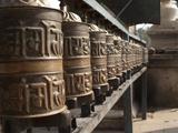 Prayer Wheels Near a Stupa in Kathmandu, Nepal Photographic Print by Greg Winston