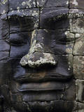 A Carved Stone Face at Bayon Temple Fotografisk trykk av Michael Melford