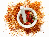 Dried Chilli Peppers and Chilli Flakes in a Mortar Fotografie-Druck von Bodo A. Schieren