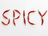 The Word 'SPICY' Written in Red Chillies Photographic Print by Peter Rees