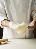 Shaping Pizza Dough by Hand (Stretching) Valokuvavedos