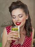 A Retro-Style Girl Drinking Lemonade Valokuvavedos