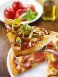 Slice of Pepperoni Pizza with Chilli Rings on Server Fotografie-Druck von Paul Williams