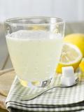 Hot Lemon with Sugar Cubes, Lemons in Background Fotografisk tryk af Kai Schwabe