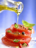 Spiced Tomatoes Being Drizzled with Olive Oil Fotografie-Druck von Jean-Paul Chassenet