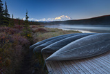 Canoes Lined Up on a Dock at Wonder Lake in Front of Mt. Mckinley Photographic Print by Ralph Lee Hopkins
