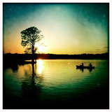 A Couple Paddles a Canoe at Sunset Past Cypress Trees Reproduction photographique par Skip Brown