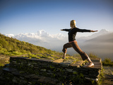 Yoga  in the Morning Sun Upon Poon Hill Along the  Anapurna Circuit - Ghorepani, Nepal Photographic Print by Dan Holz