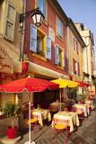 Colorful Cafe and Street Scene in Greoux-Les-Bains, Provence, France Trykk på strukket lerret av Brian Jannsen