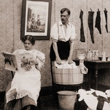 Satire of Feminism Showing an Extreme Role Reversal in a 1900's American Home Foto