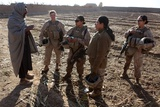Female U.S. Marines on Patrol, with a Local Afghan Man in Helmand Province, 2010 Photographie