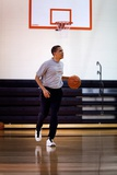 President Barack Obama Dribbles the Basketball at Fort Mcnair in Washington D.C. on May 9, 2009 Photographie