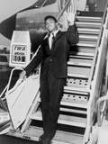 Muhammad Ali, Waves from the Steps of a TWA Airplane at JFK Airport, NYC, 1964 Photo
