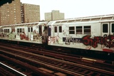 A Graffiti Painted Subway Train with Housing Projects in the Background, May 1973 Photo