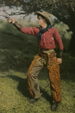 Vintage Image of a Cowboy in Traditional Clothes Aiming a Pistol Photographic Print by Franklin Price Knott