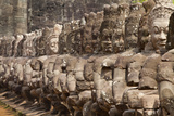 Stone Statues of Evil Line the Right Side of a Bridge At Angkor Thom Photographic Print by Kent Kobersteen