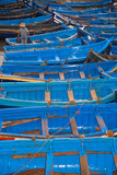 A Fisherman Stands in the Traditional Blue Boats of Essaouira Harbor Photographic Print by Cristina Mittermeier