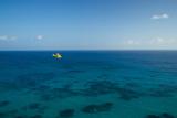 A PA18 Super Cub Floatplane Explores the Ocean Off Conception Island Reproduction photographique par Jad Davenport
