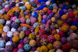 A Collection of Brightly Colored Fabric Balls Photographic Print by Cristina Mittermeier