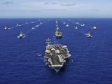 Aircraft Carrier USS Ronald Reagan Transits the Pacific Ocean with a Fleet of Ships Fotoprint van Stocktrek Images