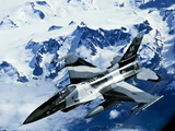 An F-16C Falcon from the 18th Aggressor Squadron Flies Over An Alaskan Mountain Range Photographic Print by Stocktrek Images
