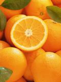 Oranges and Cut Orange, 1996 Fotografisk trykk av Norman Hollands