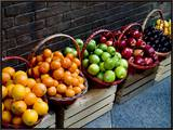 Six Baskets of Assorted Fresh Fruit for Sale at a Siena Market, Tuscany, Italy Framed Canvas Print by Todd Gipstein
