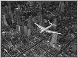 Aerial View of a Dc-4 Passenger Plane in Flight over Manhattan Impressão em tela emoldurada por Margaret Bourke-White