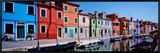 Houses at the Waterfront, Burano, Venetian Lagoon, Venice, Italy Framed Canvas Print by  Panoramic Images