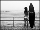 Model with Black Surfboard Standing on Boardwalk and Watching Wave on Beach Framed Canvas Print by Theodore Beowulf Sheehan