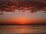 A Layer of Clouds Is Lit by the Rising Sun over Rio De La Plata, Buenos Aires, Argentina Metal Print by  Stocktrek Images