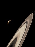 Titan's Lakes And Saturn's Rings Fotografisk tryk af David Parker