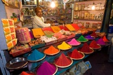Trader on Colourful Market Stall (Selling Pigments and Kumkum Powder, Incense, Oil Lamps Etc. for… Fotografie-Druck