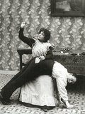 Woman Sewing a Tear on a Man's Trousers  C1895