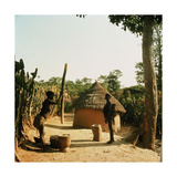 A Woman Grinding Millet with a Pestle and Mortar in a Miango Village Near Jos Giclée-tryk
