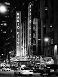 Radio City Music Hall and Yellow Cab by Night, Manhattan, Times Square, NYC, USA Fotografisk tryk af Philippe Hugonnard