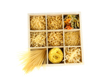 Nine Types Of Pasta In Wooden Box Sections Isolated On White Plakater af  Yastremska