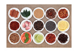 Large Spice, Herb And Food Ingredient Selection In White Porcelain Bowls Over Hessian Background Posters tekijänä  marilyna