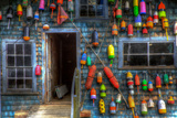 Buoys on an Old Shed at Bass Harbor, Bernard, Maine, USA Fotografie-Druck von Joanne Wells