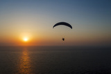 Paramotor Flying at Sunset, Aegean Sea, Western Turkey Photographic Print by Ali Kabas