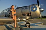 1940's Pin-Up Girl Sitting on the Wing of a World War II T-6 Texan Stampa fotografica