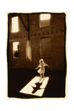 Girl dancing in a shaft of light Fotoprint van Theo Westenberger