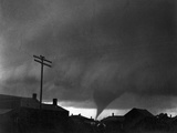 Tornado Moving Past Houses Photographic Print