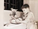 Boy Washing Dishes Impressão fotográfica por Philip Gendreau