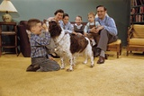 Boy Playing with the Family Dog Reproduction photographique par William P. Gottlieb