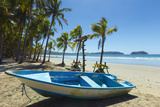 Boat on the Palm-Fringed Beach at This Laid-Back Village and Resort Fotografie-Druck von Rob Francis