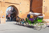 Tourists in Marrakech Enjoying a Horse and Cart Ride around the Old Medina Fotografisk tryk af Matthew Williams-Ellis
