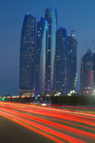 Emirate Towers and Car Tail Lights at Night, Abu Dhabi, United Arab Emirates, Middle East Fotografisk trykk av Frank Fell